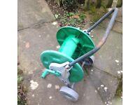 Garden hose reel trolley