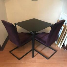 Stylish square table and two chairs