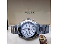 Silver Rolex Daytona with White Face Automatic Sweeping Hands