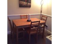 IKEA JOKKMOKK SOLID PINE DINING TABLE AND FOUR CHAIRS