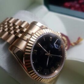 New in Boxed Rolex Datejust with black face & Roman Numerals all Gold Strap Comes in Rolex box & bag