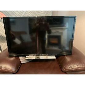 "Toshiba 32"" smart TV with remote"