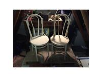 A pair of vintage bentwood bistro chairs