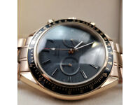 Rossco's Watches. Omega Speedmaster. Rose Gold Bracelet with Black Face. New, Boxed with Paperwork.