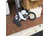 White compact pull along vacuum cleaner, good condition.