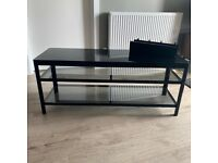 TV Stand in Black metal frame with glass shelves.