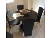 Graphite kitchen table and four leather chairs