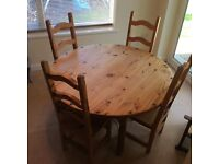 Rustic style solid wood dining table and four matching chairs