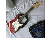 By Fender. Squier Stratocaster 60s in candy apple red