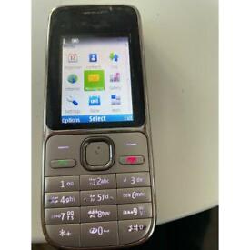 Nokia Mobile Phone and charger UK and Arabic keys