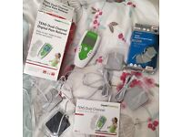 Tens Machine Dual channel pain reliever + 4 new spare pads.