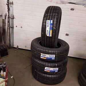 SET OF 4 NEW TIRES  235/65/R16
