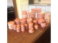 The origional suffork cannister. Henry Watson terracotta pottery. 23 pieces. Excellent condition.