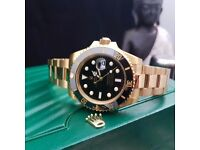 New boxed & bagged gold strap black face & bezel rolex submariner