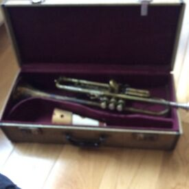 Boosey & Hawkes trumpet for sale; dates back to 1958; excellent valve action; some wear on lacquer
