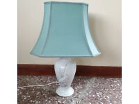 White Table lamp with bird picture on back and front comes with green lampshade .