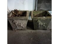 two heavy nicely weathered masonry plant pots can deliver