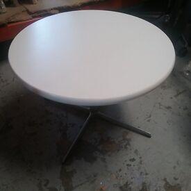 Low white circular coffee table