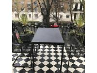 Table and outdoor chairs and bench