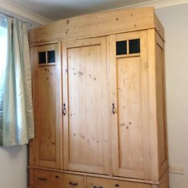 Lovely waxed pine wardrobe. Three doors, two drawers,hanging rail and shelves.