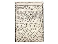 beautiful big black white fuzzy rug with berber style pattern design boho chic interior