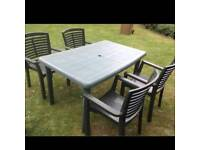 Green plastic garden table & 4 chairs