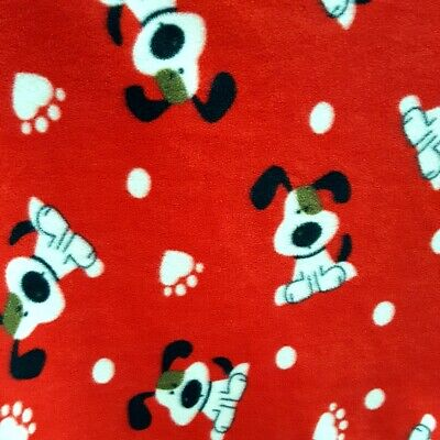 - Fleece Fabric DOGGY SPOT PRINT ON RED FLEECE 60