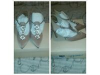Two pairs of faith shoes
