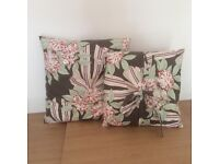 King sized bed wooden and fabric covered headboard and 2 cushions