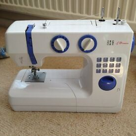 Used Bush 988 sewing machine. Comes with instructions & foot pedal.