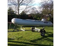 Rigid inflatable dinghy with 6hp Honda outboard and road trailer