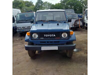 Left hand drive Toyota Landcruiser Turbo BJ73 4X4 convertible jeep.