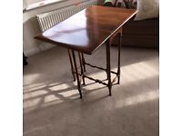 Gateleg table in yew wood
