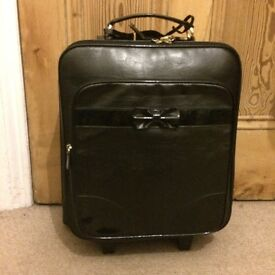 Topshop small black wheelie suitcase with patent bow