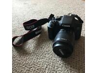 Canon EOS 750D camera with lense and case.