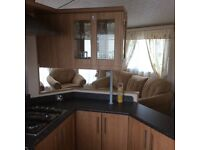 38ft x 12 ft 2 berth ,well loved double glazed with central heated Caravan with two bathrooms