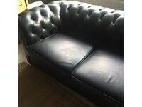 Black vintage distressed Chesterfield sofa