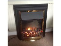 Dimplex electric fire with coal effect and back lighting