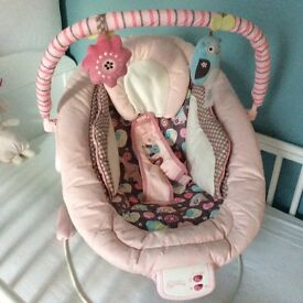 Mothercare Bouncy Chairs. Pink and Turquiose As new. Granny selling 2 of them.