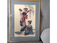 Framed needlepoint tapestry of two beautifully dressed Japanese women