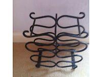 Old cast iron wine rack