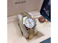 Twotone Rolex Daytona , white face, gold bezel. Comes Rolex Boxed with paperwork