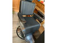 Three barbering chairs