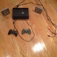 Play station 3 with 2 controllers and 2 free games for sale