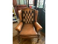 Classic wing back armchair in brown leather
