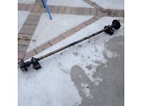 Universal solid trailer axle with mounting brackets