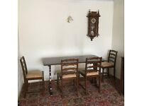 Long french polished dark wood dining table with 4 chairs