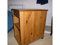 small pine storage cabinet on wheels