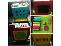 Wooden mother care activity cube with wheels
