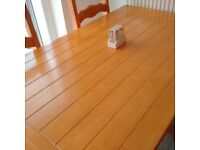 Lovely solid pine table and four chairs for sale